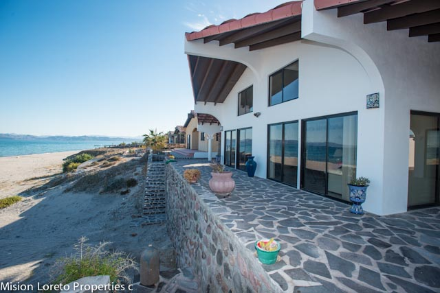 Two Beachfront Homes in one! Main Casa + paved ramp to beach between the boat garage with guest suite